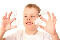 Niño con rompecabezas Fotografía de archivo libre de regalías