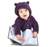 Niño con un libro Imagen de archivo libre de regalías