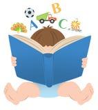 Niño con un libro Imágenes de archivo libres de regalías