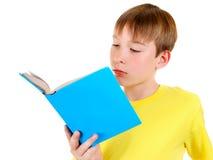 Niño con un libro Foto de archivo libre de regalías