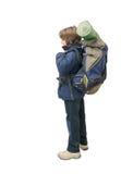 Niño con un morral listo para un viaje Fotografía de archivo libre de regalías