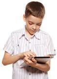 Niño con un Tablet PC Imagenes de archivo