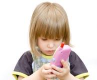 Niño con un teléfono del juguete Foto de archivo libre de regalías