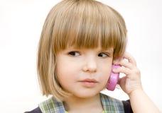 Niño con un teléfono del juguete Imagen de archivo