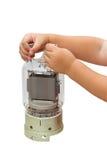 Niño con un tubo de vacío de gran alcance Imagenes de archivo