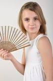 Niño con un ventilador Imagen de archivo libre de regalías