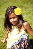 Niño con una flor Imagen de archivo libre de regalías