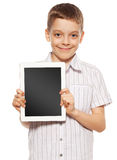 Niño con una PC de la tablilla Fotografía de archivo