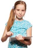Niño con una PC de la tablilla Fotos de archivo libres de regalías