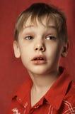 Niño confuso Foto de archivo