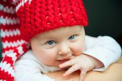Bebé en sombrero rojo Foto de archivo libre de regalías