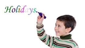Niño de Adorables que escribe la palabra Fotografía de archivo