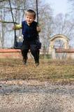 Niño de balanceo Fotos de archivo libres de regalías