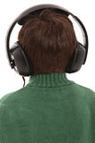 Niño de la cara posterior con los auriculares Imagen de archivo libre de regalías