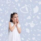 Niño de la muchacha en el fondo de la textura de las cosas de la muchacha Imagen de archivo libre de regalías