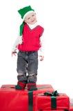 Niño de la Navidad con los presentes Imágenes de archivo libres de regalías