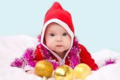 Niño de la Navidad en el sombrero de Papá Noel Fotos de archivo libres de regalías