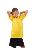 Niño de los deportes aislado en un fondo blanco Muchacho lindo con una bola del soccrr Futbolista joven Concepto activo de la niñ Fotos de archivo