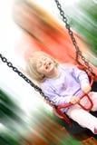 Niño de risa en el oscilación Fotografía de archivo