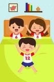 Niño de salto en la cama Fotografía de archivo libre de regalías