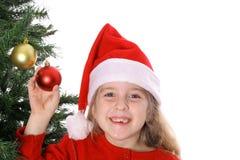 Niño de Santa por el árbol de navidad Fotos de archivo