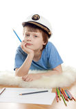 Niño de sueño lindo en casquillo del capitán Imagenes de archivo