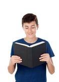Niño del adolescente con un libro Fotos de archivo libres de regalías