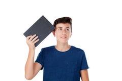 Niño del adolescente con un libro Imagen de archivo libre de regalías