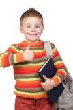 Niño del estudiante con los libros que dice OK Imagenes de archivo