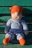 Niño del juguete en el banco Imágenes de archivo libres de regalías