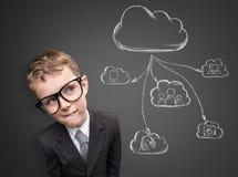 Niño del negocio que piensa en la tecnología futura Imagen de archivo libre de regalías