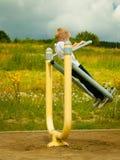 Niño del niño en juego del muchacho de la acción en estirar el equipo Imagen de archivo