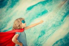 Niño del super héroe en casa Imagen de archivo libre de regalías