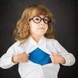 Niño del super héroe en clase Imágenes de archivo libres de regalías