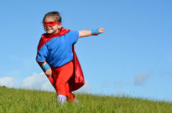 Niño del super héroe - poder de la muchacha Fotos de archivo