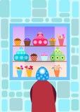 Niño delante de una ventana de la tienda del caramelo Foto de archivo