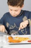 Niño dinner_4 Fotografía de archivo libre de regalías