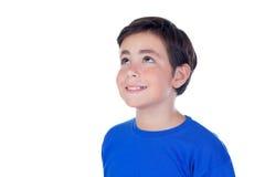 Niño divertido con diez años y la camiseta azul Imágenes de archivo libres de regalías
