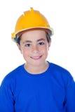 Niño divertido con el casco amarillo Foto de archivo libre de regalías