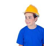 Niño divertido con el casco amarillo Foto de archivo