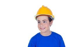 Niño divertido con el casco amarillo Imagenes de archivo