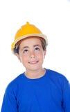 Niño divertido con el casco amarillo Imagen de archivo libre de regalías