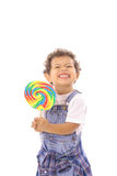 Niño divertido de la cara con el lollipop grande Foto de archivo libre de regalías