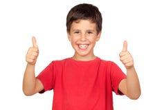 Niño divertido que dice OK Imagenes de archivo