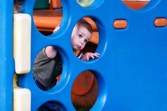 Niño en área de juego Foto de archivo libre de regalías