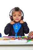 Niño en auriculares Foto de archivo libre de regalías