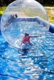 Niño en bola del agua Foto de archivo libre de regalías