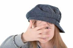 Niño en casquillo Fotos de archivo
