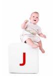 Niño en el bloque con la carta Fotos de archivo libres de regalías