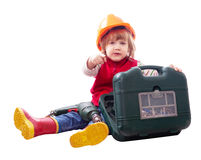 Niño en el casco de protección con el taladro y la caja de herramientas Imagenes de archivo